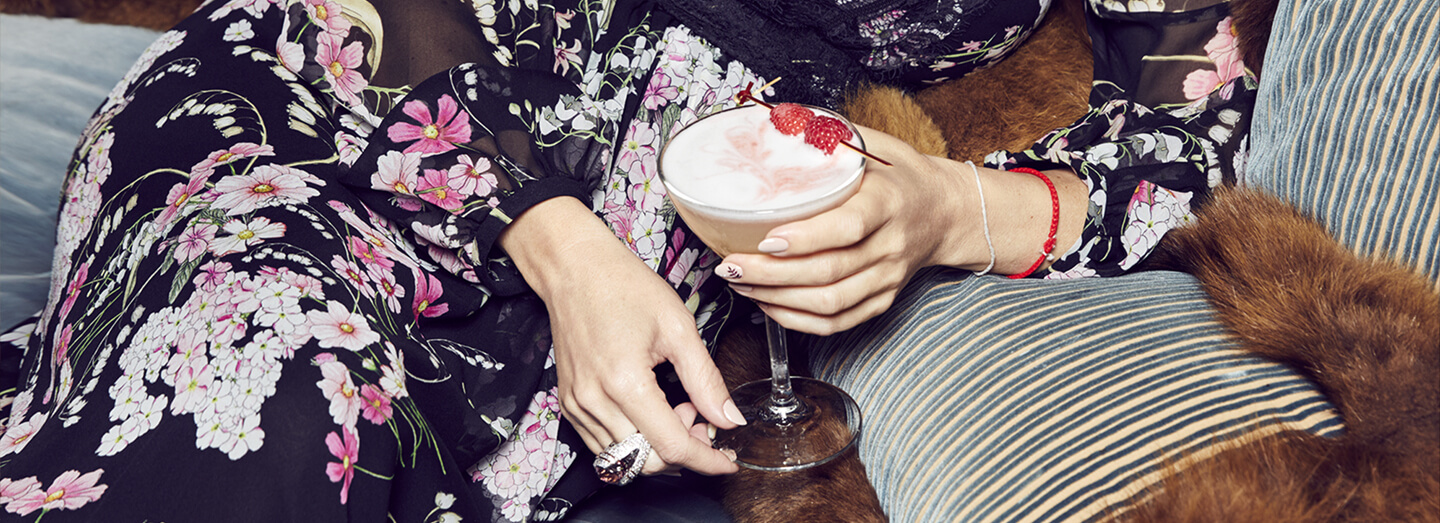 Picture of Kate holding a glass of King Cocktail.